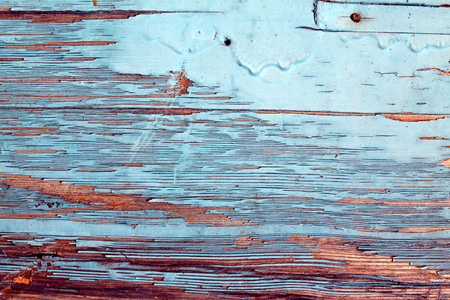 old blue board with cracked paint, vintage wood background, grunge plank. Old wooden background with remains of pieces of scraps of old paint on wood. Texture of an old tree, board with paint, vintage background peeling paint. old blue board with cracked paint, vintage, wood, background old blue board with cracked paint, vintage wood background, grunge plank.
