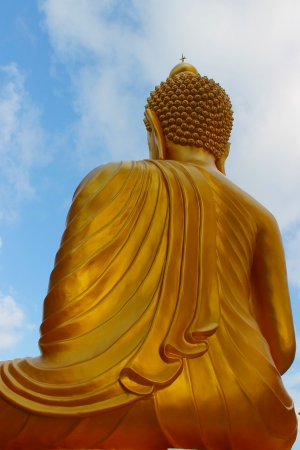 Golden big Buddha statue with blue sky Stock Photo - 14941656