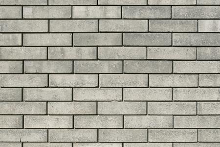Beige brick wall texture background