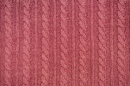 Red knitted fabric with a pattern a braid texture knitwear