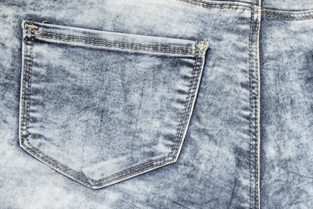 Acid washed jeans with a pocket texture of denim Banco de Imagens