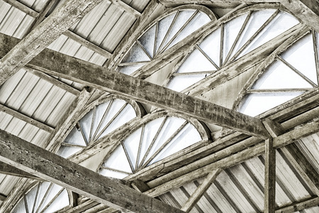 Arched Windows under the dome of tin gray sheets and painted wooden beams Фото со стока