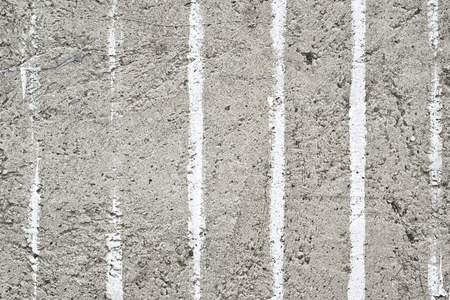 White parallel stripes of paint on concrete wall