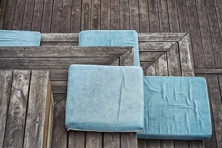 Turquoise plush seat pad on the boardwalk stairs