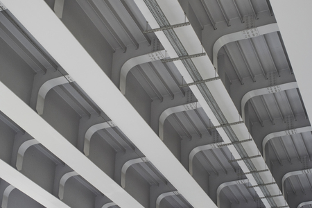 Reinforced concrete construction of the overpass bottom view of the urban landscape under the bridge