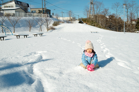 rightwing: Children sit on the snow Stock Photo