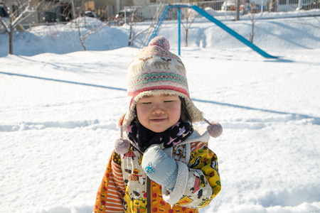 resuscitate: Children playing in the Park in winter