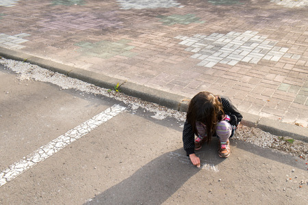 rightwing: Children draw a picture on the ground Stock Photo
