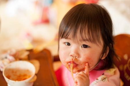 spaghetti sauce: Diet in infants Stock Photo