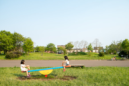 Group of children playing on the seesaw Standard-Bild