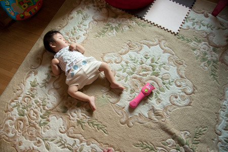 drowsiness: Lovely baby Stock Photo