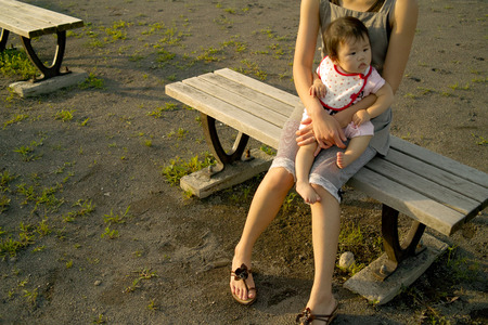 rightwing: Parents and children sit on the bench