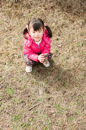 pinecones: Girl with pinecones