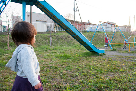 interested baby: little girl on a playground