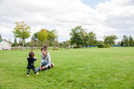 children play: Parents and children play on the lawn