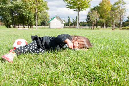 lie: Children lie on the lawn Stock Photo