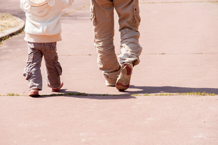 Parent and child walking feet Stock Photo