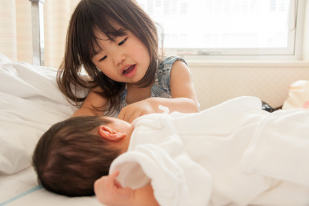cherishing: Child nursing a baby