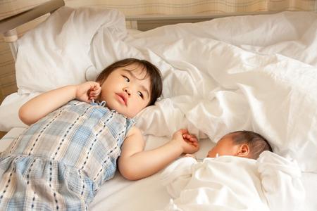 cherishing: Child stare at baby