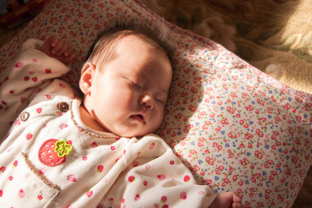 waist deep: Sleeping baby Stock Photo