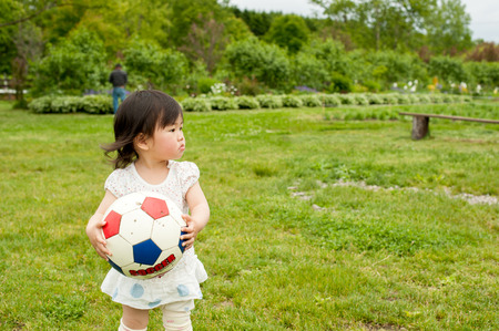 Child with ball Stock Photo