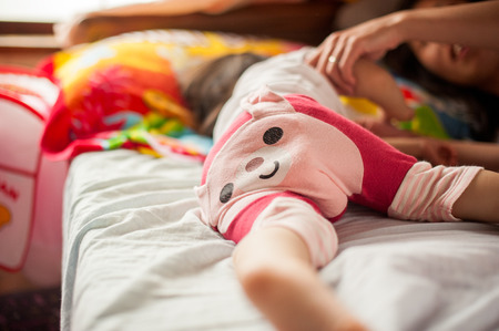 baby ass: Children lie on the bed Stock Photo