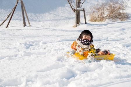 rightwing: Children lie on the sled