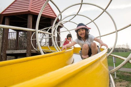 rightwing: Children play on the slide