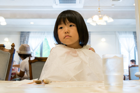 named person: Girl wearing a paper napkin Stock Photo