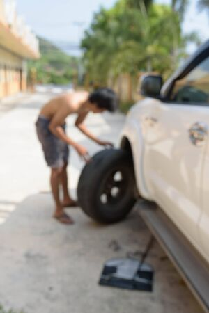 Blur technician was changing the tire. Stock Photo