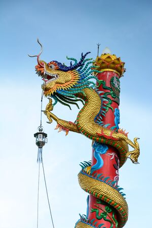 greatness: Dragon pole climbing, sky background Represent greatness.