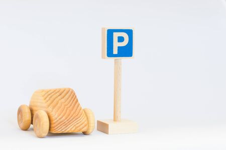 labelling: Traffic sign and wooden car Stock Photo