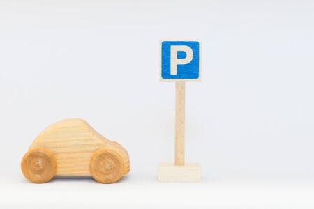 Traffic sign and wooden car Stock Photo