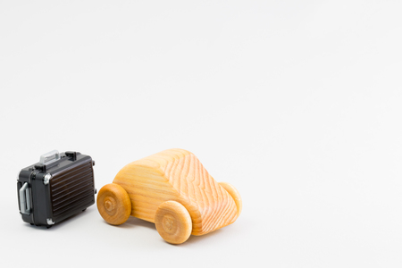 lifelike: Wooden car and miniature of the suitcase