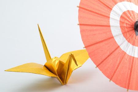 composure: Japanese umbrella and origami Stock Photo
