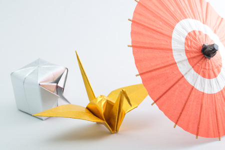 small articles: Japanese umbrella and origami Stock Photo