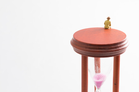 hour glass figure: A hourglass and old man
