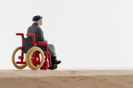 Oude man van de rolstoel Stockfoto