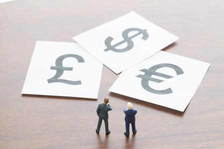 gb pound: Businessmen thinking about exchange