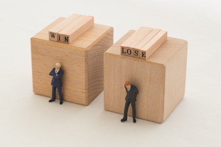 disadvantages: Winner and loser Stock Photo