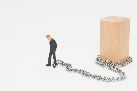 Businessman in chains Stock Photo