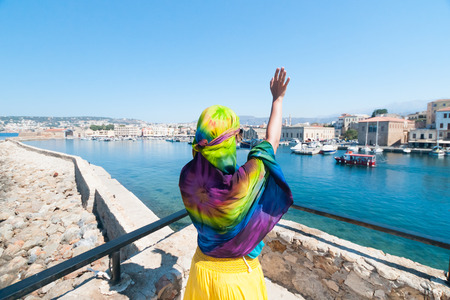parting the sea: Girl in a scarf waving to passing ship from the shore