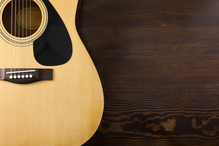 acoustic guitar on wooden table Фото со стока