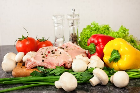 eating meat: meat and vegetables on table Stock Photo