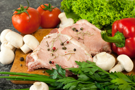 raw vegetables: Raw meat and vegetables on table Stock Photo