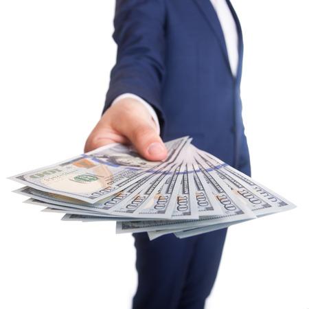 Geschäftsmann Anzeigen einer Verbreitung von Dollar isoliert auf weiß Lizenzfreie Bilder