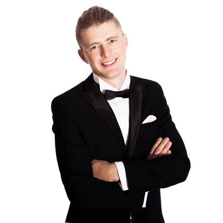 man in tuxedo: young elegant smiling man in tuxedo isolated on white