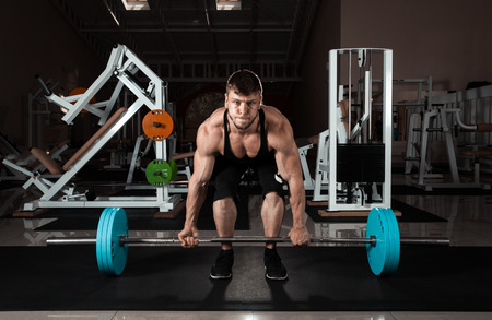 Muscular Man Lifting Deadlift In The Gym Stock Photo