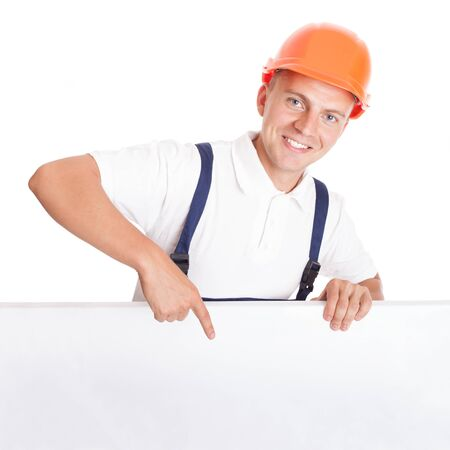 journeyman technician: Construction worker leaning over and pointing to blank, isolated on white