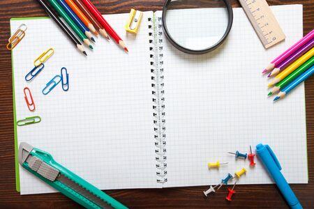 Assortment of school items on wooden background Standard-Bild